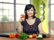 Nutrition coach raising a toast with detox drink Royalty Free Stock Image