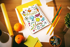 Nutrition concept. Top view of wooden desktop with creative sketch in spiral notepad, fruit and supplies. Nutrition concept royalty free stock photography