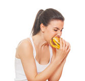 Nutrition concepts. Portrait of a young woman eating. Isolated on white Stock Images