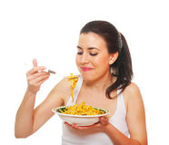Nutrition concepts. Portrait of a young woman eating. Isolated on white Stock Image
