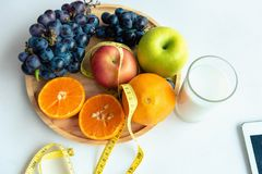 Nutrition and diet concept, Mix fruit for dieting with measuring. Tap stock photography