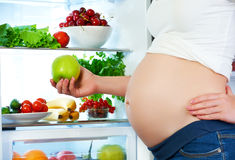Nutrition and diet during pregnancy. Pregnant woman with fruits Royalty Free Stock Image