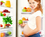 Nutrition and diet during pregnancy. Pregnant woman with fruits Royalty Free Stock Images