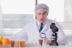 The nutrition expert testing food products in lab Stock Photos