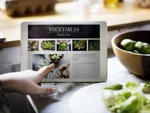Nutrition facts of fresh vegetable on digital tablet stock photography