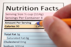 Nutrition Facts. And hand with ballpoint pen. Close-up royalty free stock image