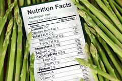 Nutrition facts of raw asparagus Stock Photos