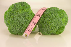 Broccoli with Tape Measure on white Stock Image