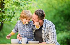 Nutrition habits. Family enjoy homemade meal. Family time. Nutrition kids and adults. Little boy and dad eat. Everything. Is more fun with father. Organic royalty free stock image
