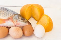 Nutrition healthy proteins vitamins fish eggs and cheese. Nutrition healthy  fish eggs and cheese Stock Photos