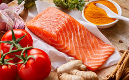 Nutrition for the heart and cardiovascular system. Nutrition for a healthy heart and cardiovascular system with fresh raw salmon rich in omega-3 fatty acids royalty free stock photography