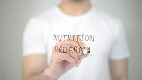 Nutrition Program, man writing on transparent screen royalty free stock image