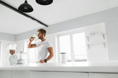 Nutrition Supplements. Man Drinking Protein Shake Before Workout royalty free stock images