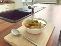 Nutritional soup with green broccoli in plate. On wood table Royalty Free Stock Image