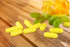 Nutritional supplement. Vitamin pill herbal medicine herb capsule medicine healthcare and medicine Stock Image