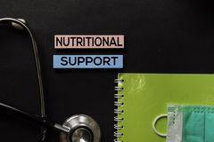 Nutritional Support on top view black table and Healthcare/medical concept royalty free stock image