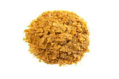 Nutritional yeast pile, isolated on white ( Saccharomyces cerevisiae) Royalty Free Stock Images