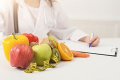 Nutritionist desk with fruit and measuring tape stock photography