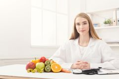 Nutritionist desk with fruit and measuring tape royalty free stock photography