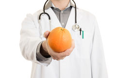 Nutritionist doctor, giving an orange, isolated Stock Images