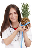 Nutritionist Doctor Measuring a Pineapple Fruit Royalty Free Stock Photo