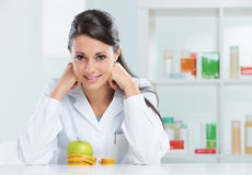 Nutritionist Doctor. Portrait of a nutritionist female Doctor in her office Stock Photos
