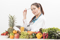Nutritionist doctor woman. Isolated on white Royalty Free Stock Photography