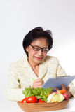 Nutritionist. Female Asian Nutritionist act with a bowl of vegetable for diet Stock Photo