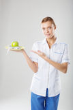 Nutritionist female Doctor holding a green apple Royalty Free Stock Photography