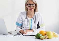 Nutritionist female doctor. Nutritionist young blonde female doctor Stock Images
