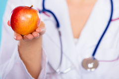Nutritionist holding apple fruit in her hand Royalty Free Stock Photo