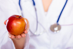 Nutritionist holding apple fruit in her hand Stock Photography