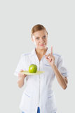 Nutritionist holding hands green apple Stock Images