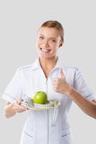 Nutritionist holding hands green apple Royalty Free Stock Image