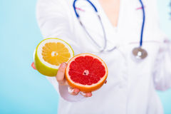 Nutritionist holding some fruits in her hand Stock Photography