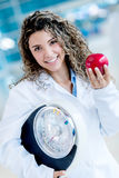 Nutritionist holding weight scale Royalty Free Stock Photo
