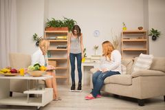Healthy lifestyle explanation. Nutritionist office. Slim paient standing on scales stock image