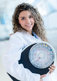 Nutritionist with a weight scale Stock Photos