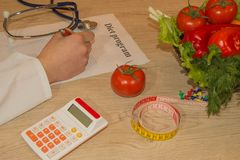 Nutritionist writing medical records and prescriptions with fresh fruits. Healthy, Diet concept Stock Photography