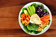 Nutritious bowl with avocado, hummus and vegetables Royalty Free Stock Photography
