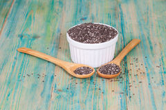 Nutritious chia seeds in bowl and spoon Stock Image