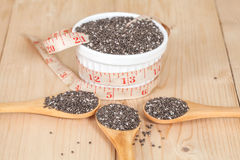 Nutritious chia seeds in bowl and spoon Stock Photo