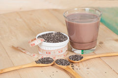 Nutritious chia seeds in bowl and spoon Royalty Free Stock Photo