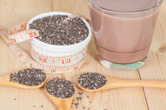 Nutritious chia seeds in bowl and spoon Stock Photos