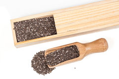 Nutritious chia seeds in wood box and spoon Royalty Free Stock Images