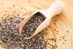 Nutritious chia seeds. On a wooden spoon Stock Photography