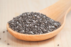 Nutritious chia seeds in  wooden spoon on wood Royalty Free Stock Images