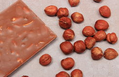 Nutritious chocolate and hazelnuts on cement structure Royalty Free Stock Photography