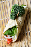 Nutritious food. Vegetable rolled tortilla with broccoli on it stock image