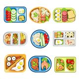 Nutritious complex lunches in convenient plastic trays set. Nutritious healthy complex lunches composed of fried eggs, fresh vegetables, meat or fish, exotic Royalty Free Stock Image